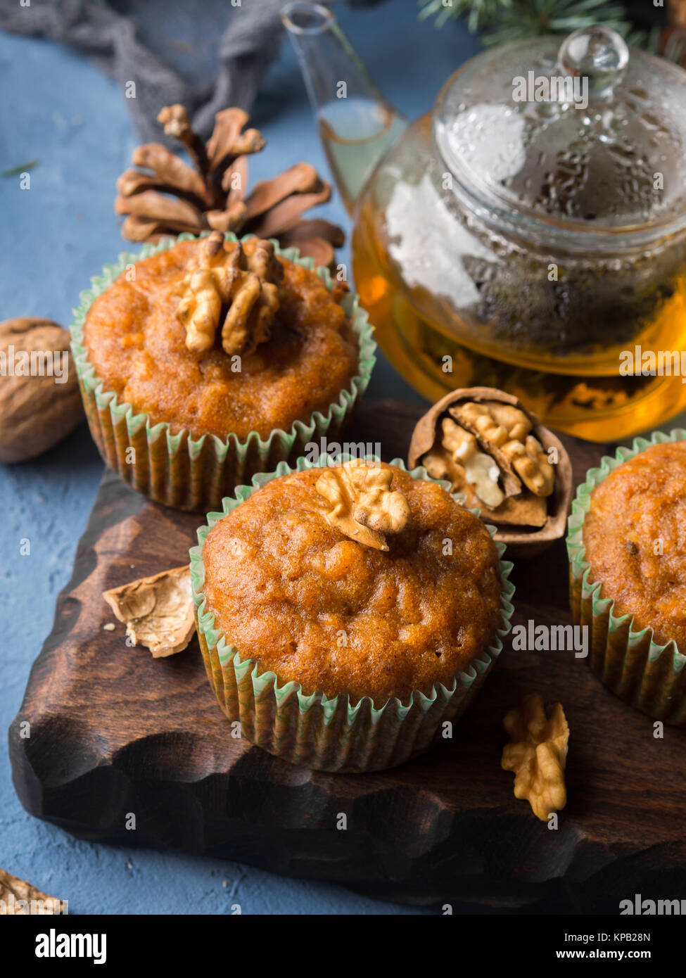 Home made Carrot spiced muffins with walnuts. Winter holiday treat - Stock Image