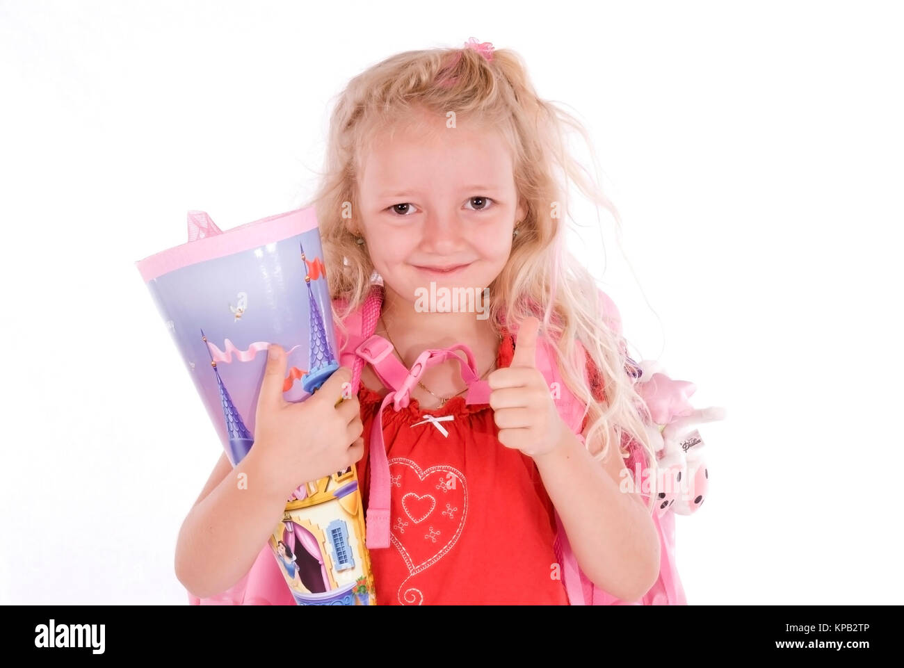 Model release, Schulanfaengerin mit Schultuete - first grader with First-Day-of School-cornet - Stock Image