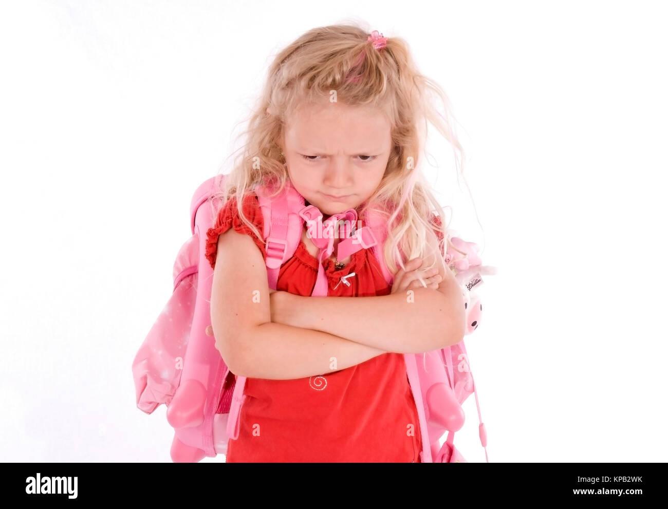 Model release, Schulmaedchen mit boesem Blick - school girl with bad look Stock Photo