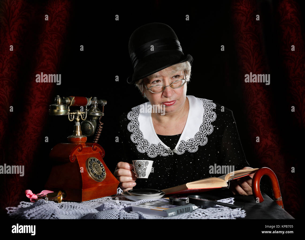 The old woman is like a Miss Marple,woman Miss Marpul, English detective character, woman detective, from the book - Stock Image