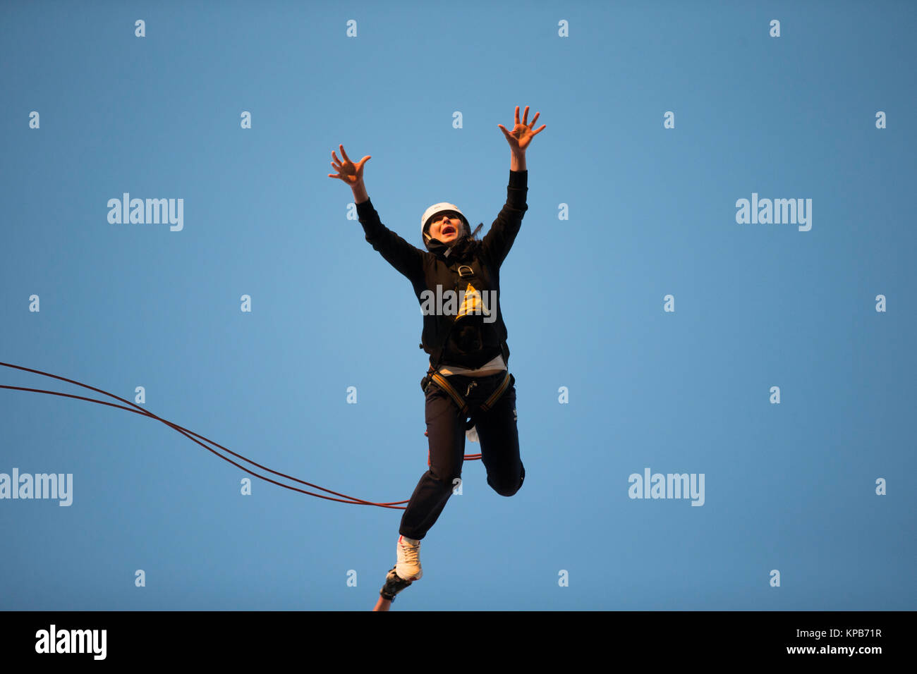 Belarus, Gomel, 10.03.2017 year Jumping from the bridge with a rope. RoupeJumping - Stock Image