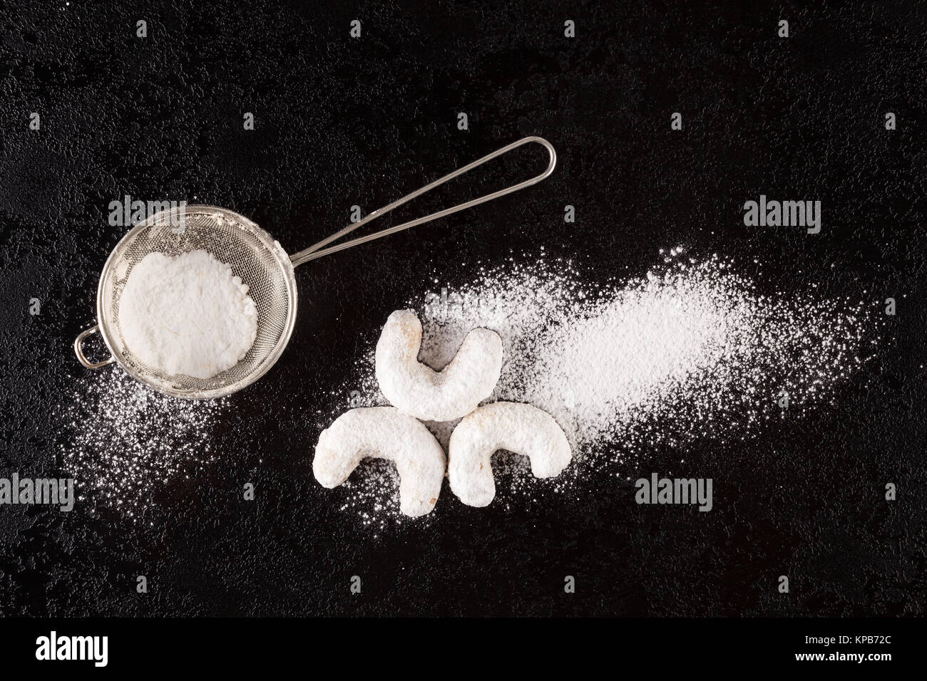 Christmas baking. Sifter with christmas vanilla breads from above.  Flat lay. - Stock Image