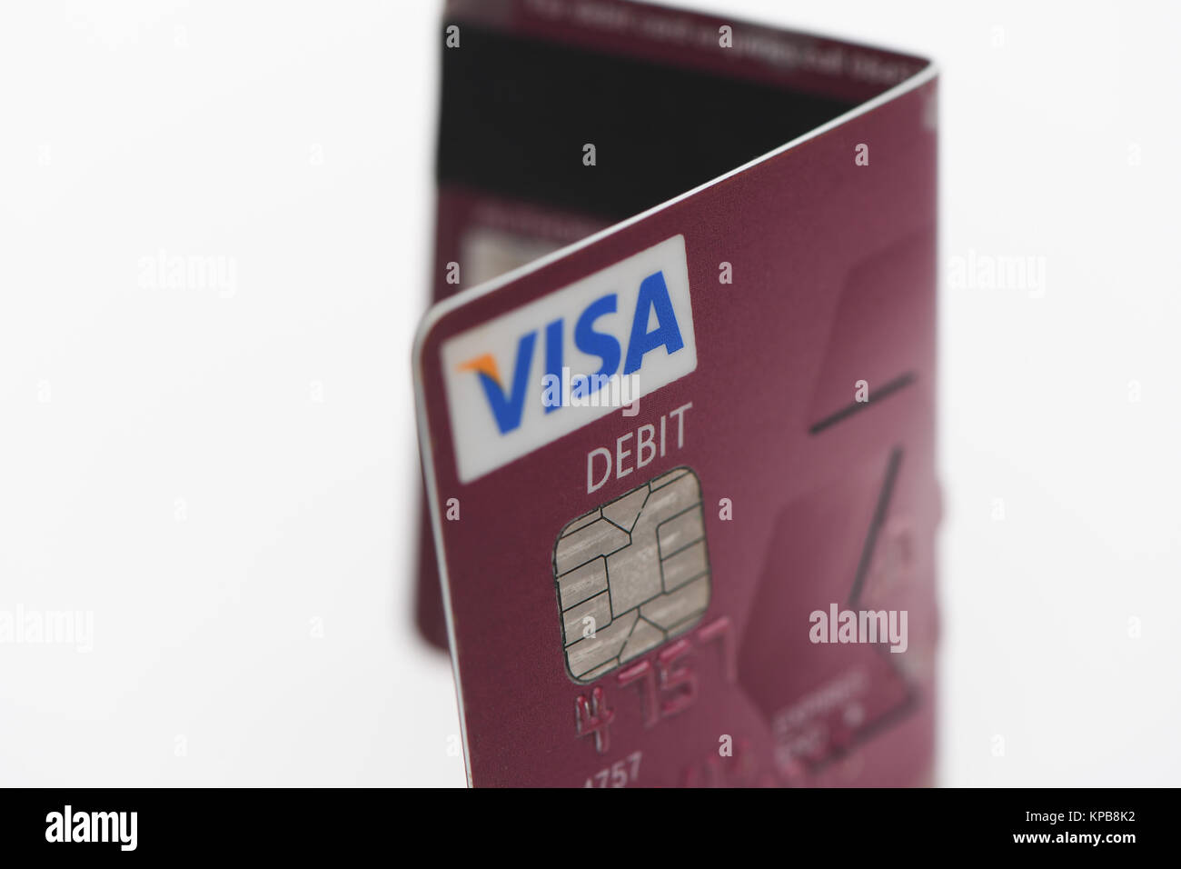 A folded Visa  debit card from Nat West on white background. - Stock Image