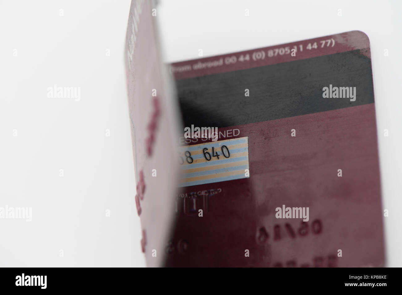 A folded Visa  debit card from Nat West on white background. Stock Photo