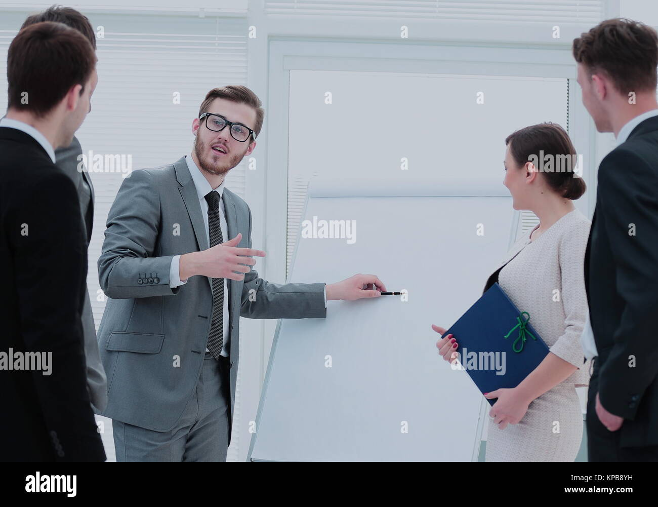 Business woman making a business presentation to a group Stock Photo