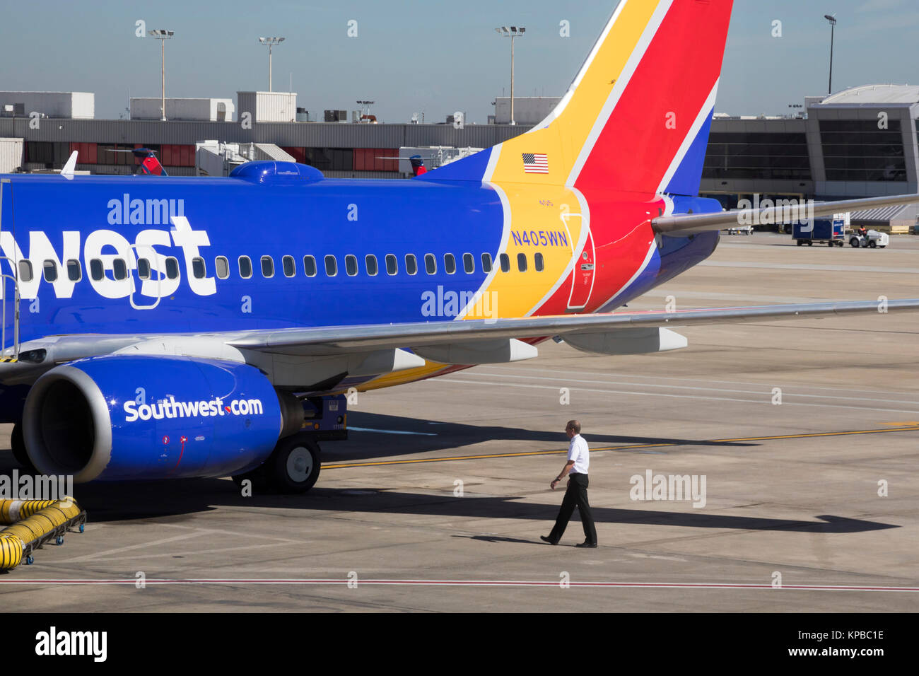 Atlanta, Georgia - A Southwest Airlines pilot does a visual inspection of his airplane before a flight from Hartsfield–Jackson - Stock Image