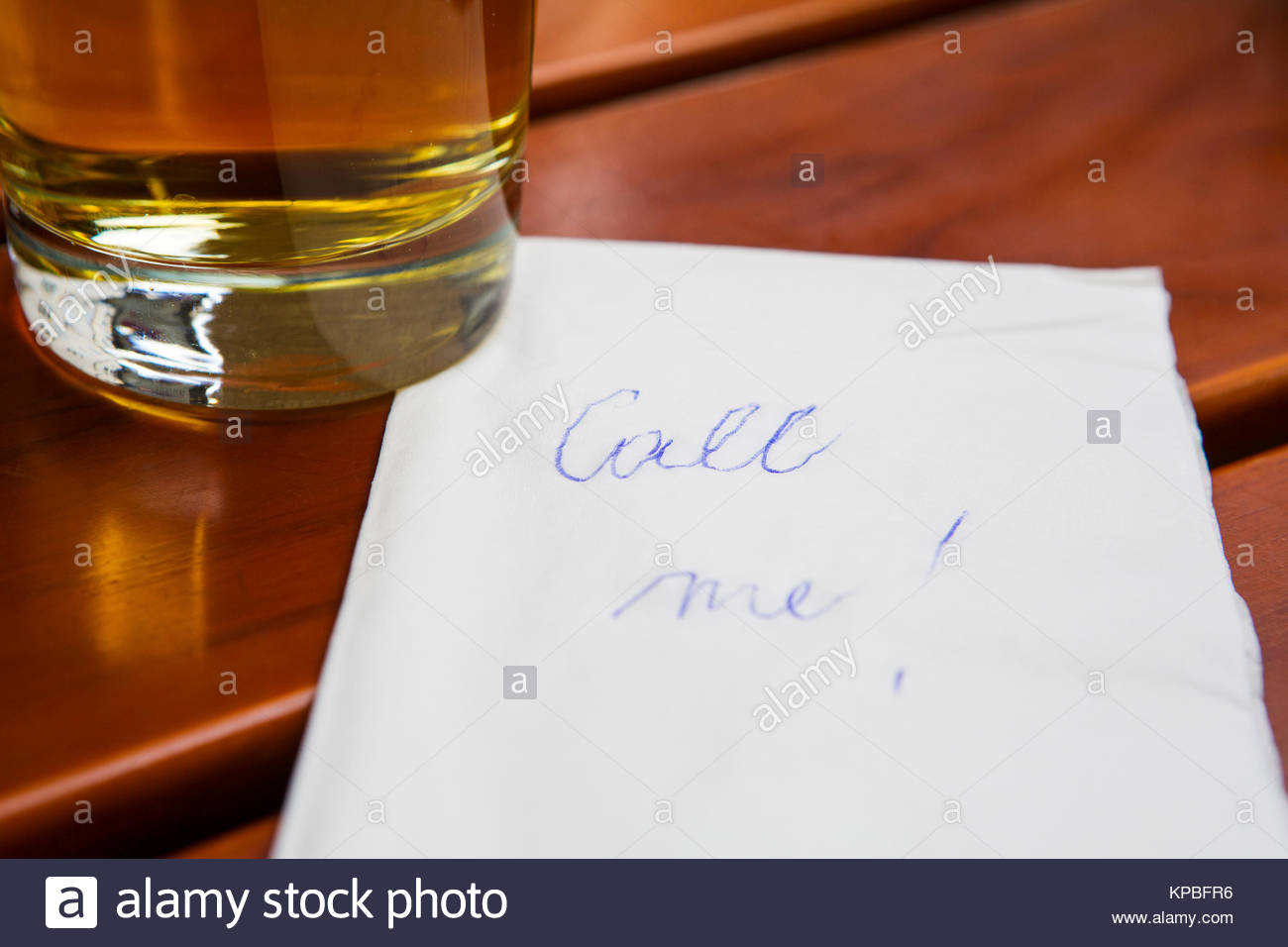 notecall me next to a glass of beer - Stock Image