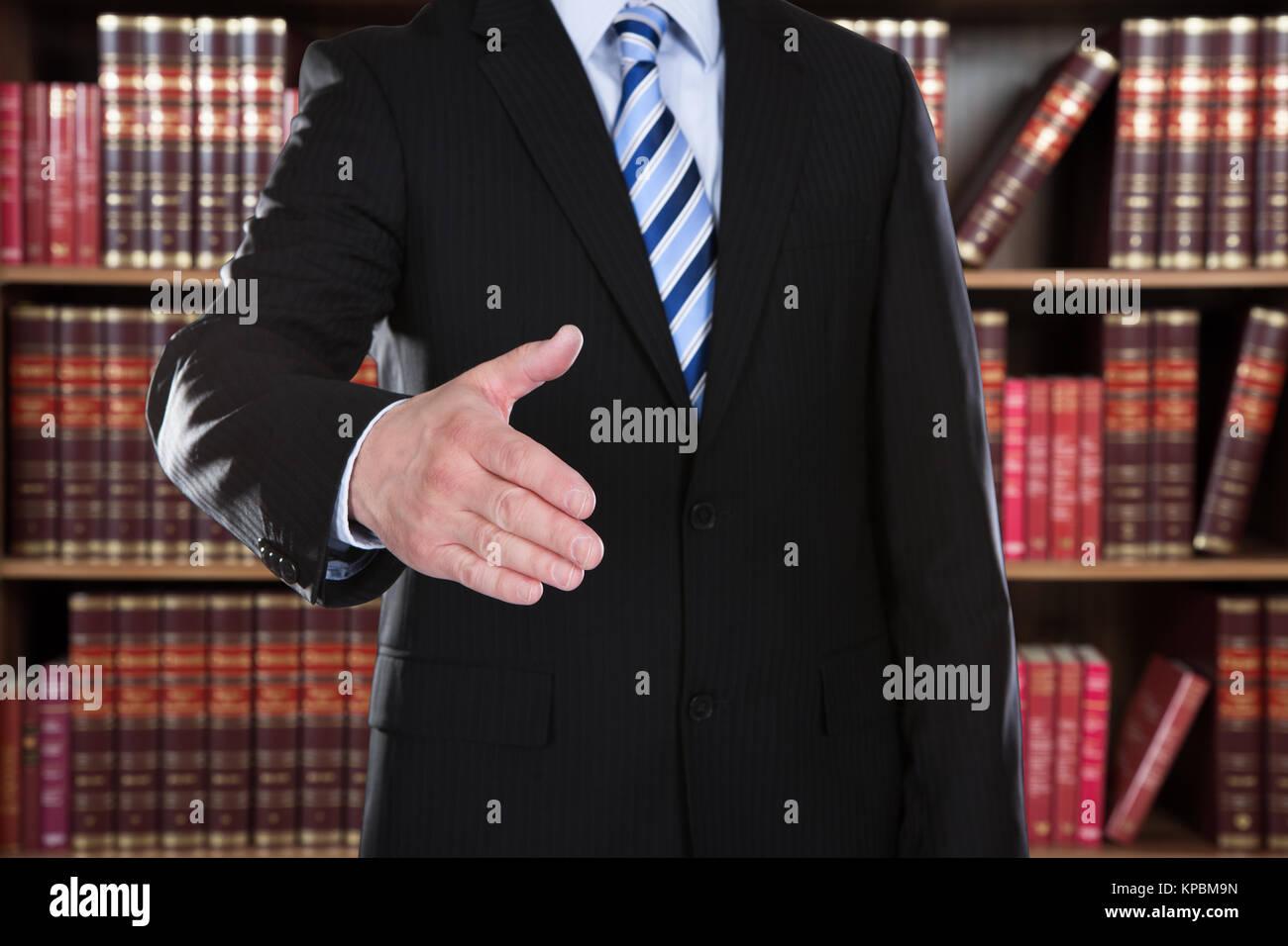 Close-up Of Businessman Offering Handshake - Stock Image