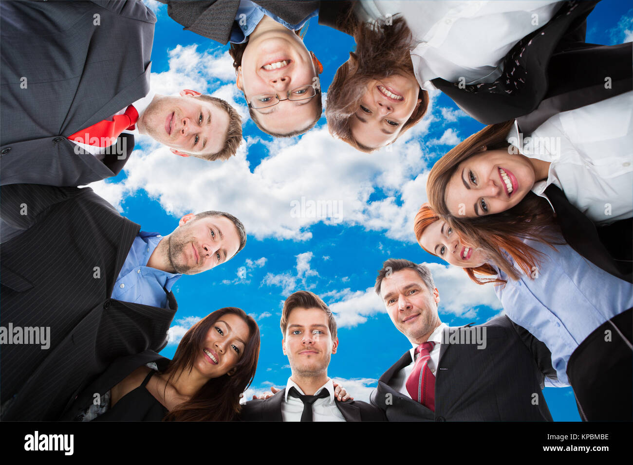 Business people standing in circle Stock Photo