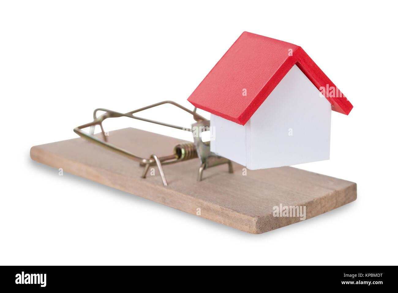 Closeup Of House Miniature On Mousetrap Stock Photo