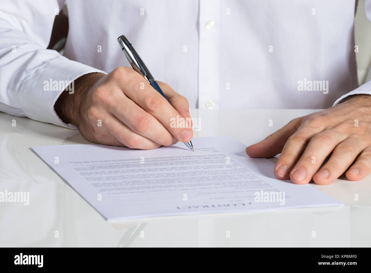 Businessman Signing Contract Document - Stock Image