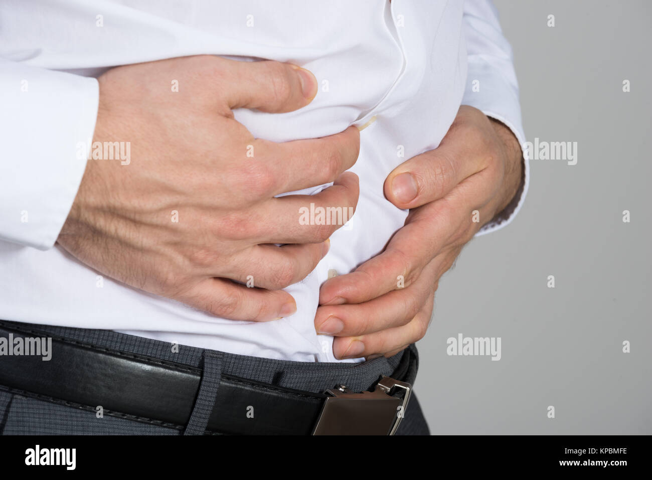 Businessman Suffering From Stomach Ache - Stock Image
