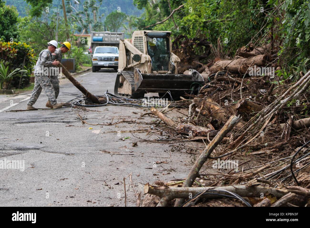 U.S. National Guard soldiers clear debris from Road 123 during relief efforts in the aftermath of Hurricane Maria - Stock Image