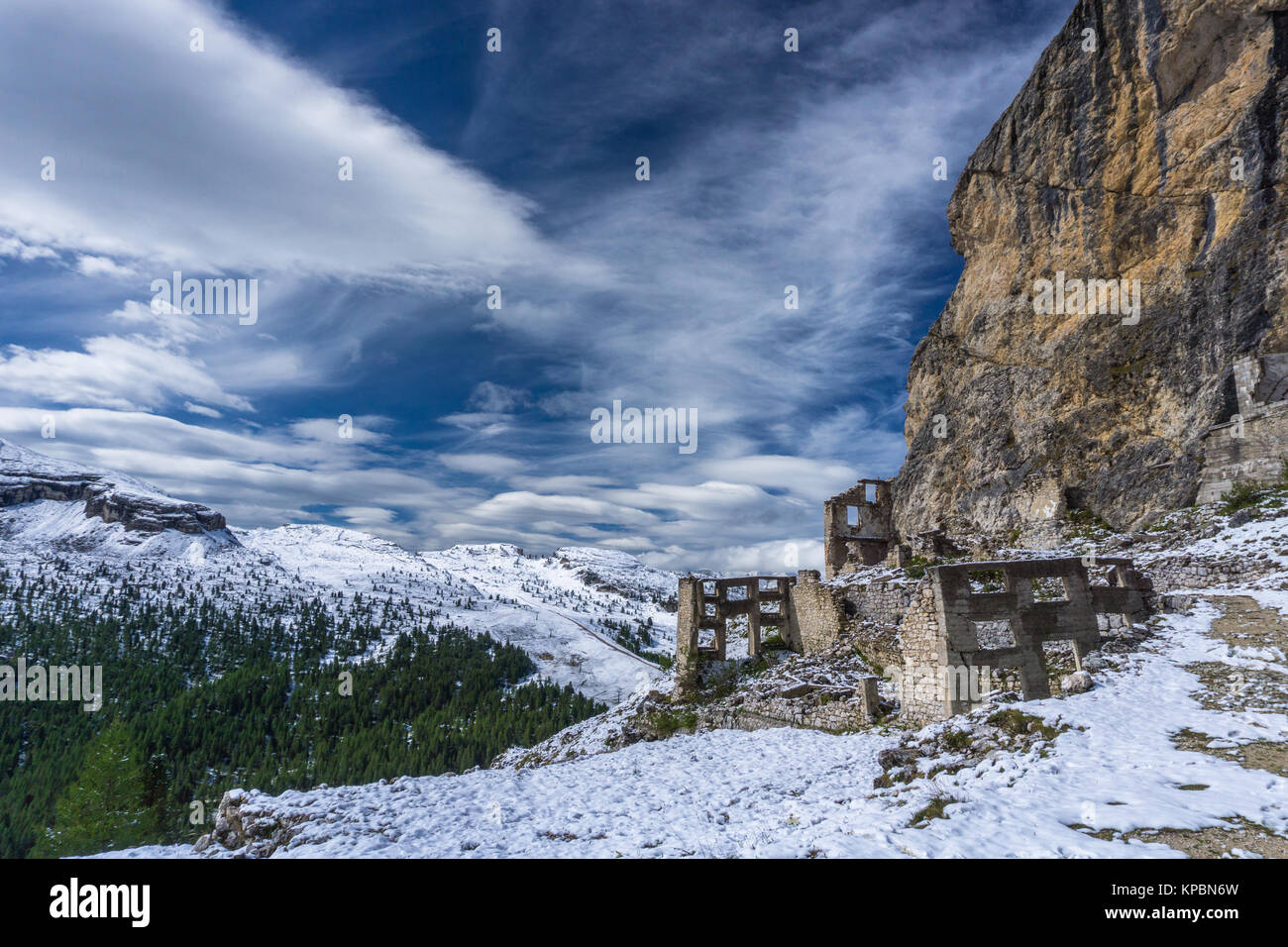 Dolomite mountain landscape after a fresh snowfall in late autumn with ruins of a World War One fortress - Stock Image