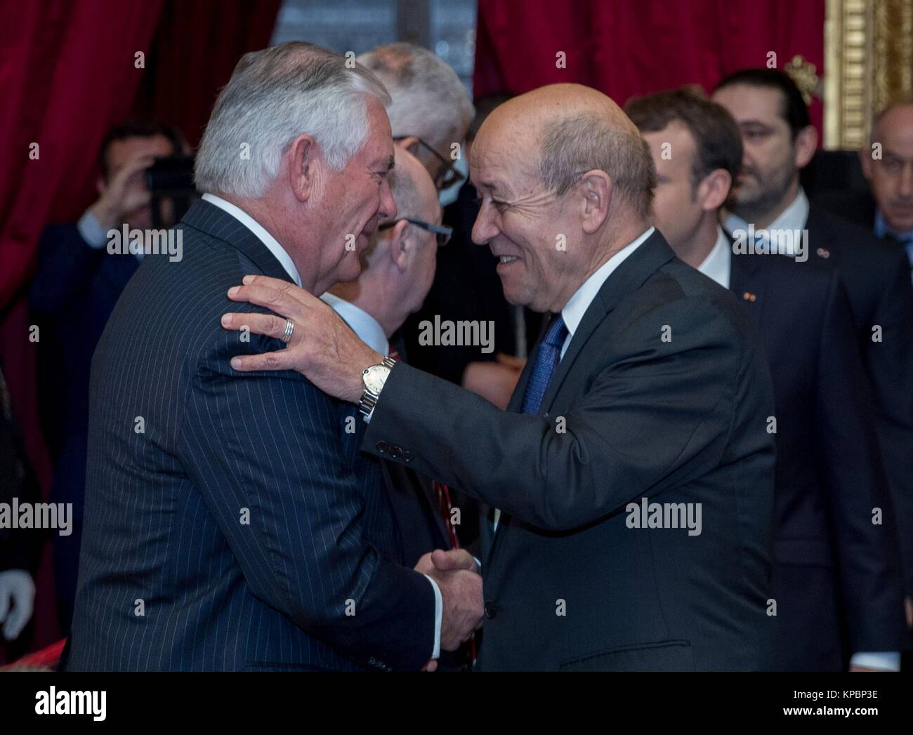 U.S. Secretary of State Rex Tillerson (left) greets French Foreign Minister Jean-Yves Le Drian during the International Stock Photo