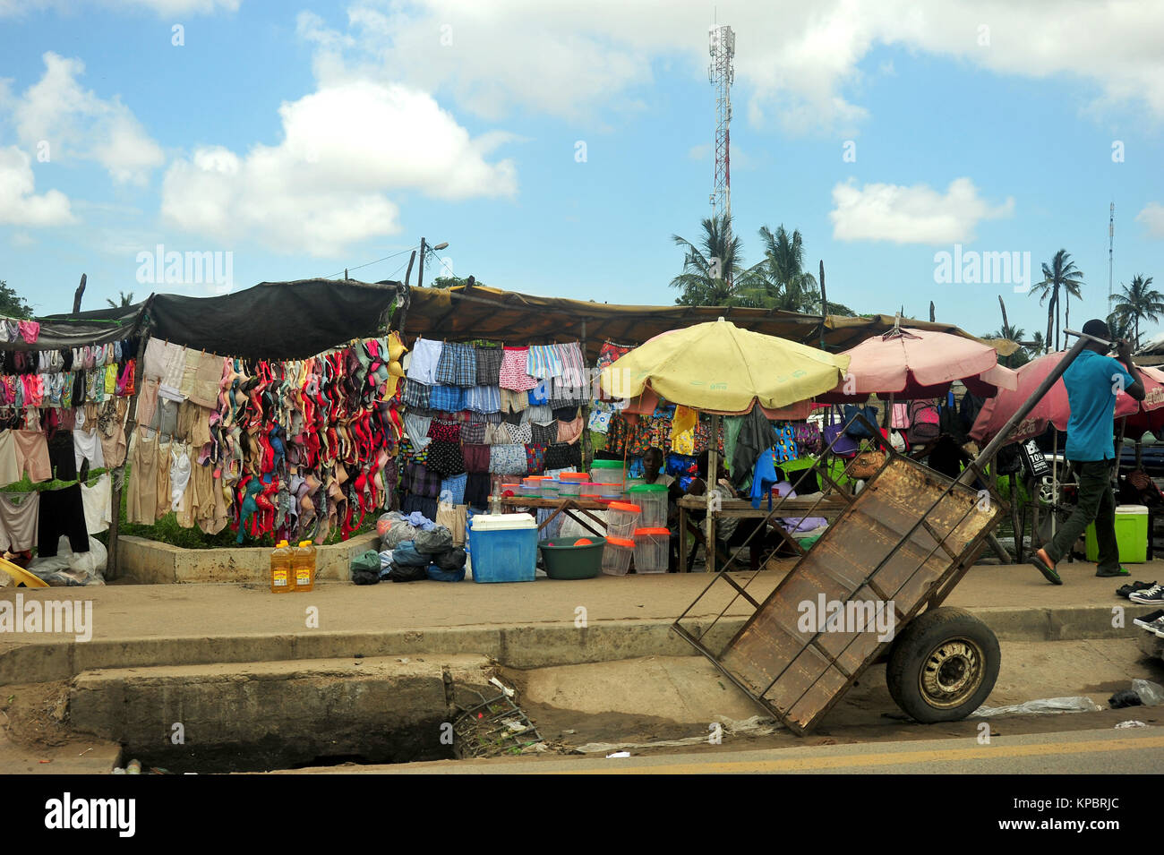 A row of street stalls and shops in Maputo, Mozambique. Stock Photo
