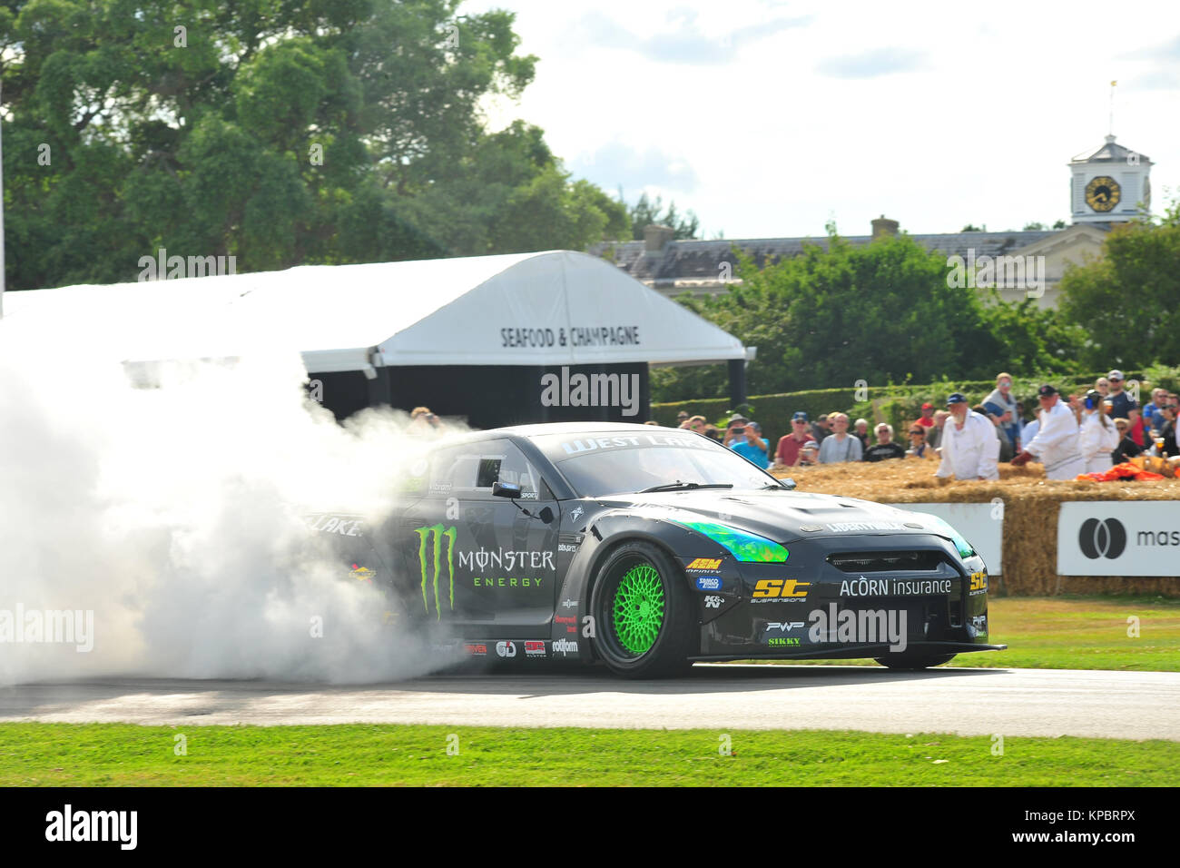A car performing a burn out at the 2017 Goodwood Festival of Speed. - Stock Image