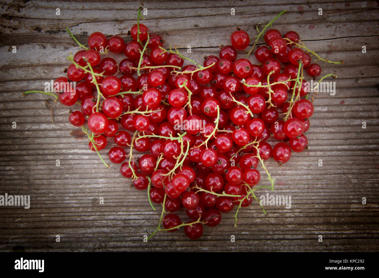 Heart shape from redcurrant. Love theme concept for Valentine's background and love theme. - Stock Image