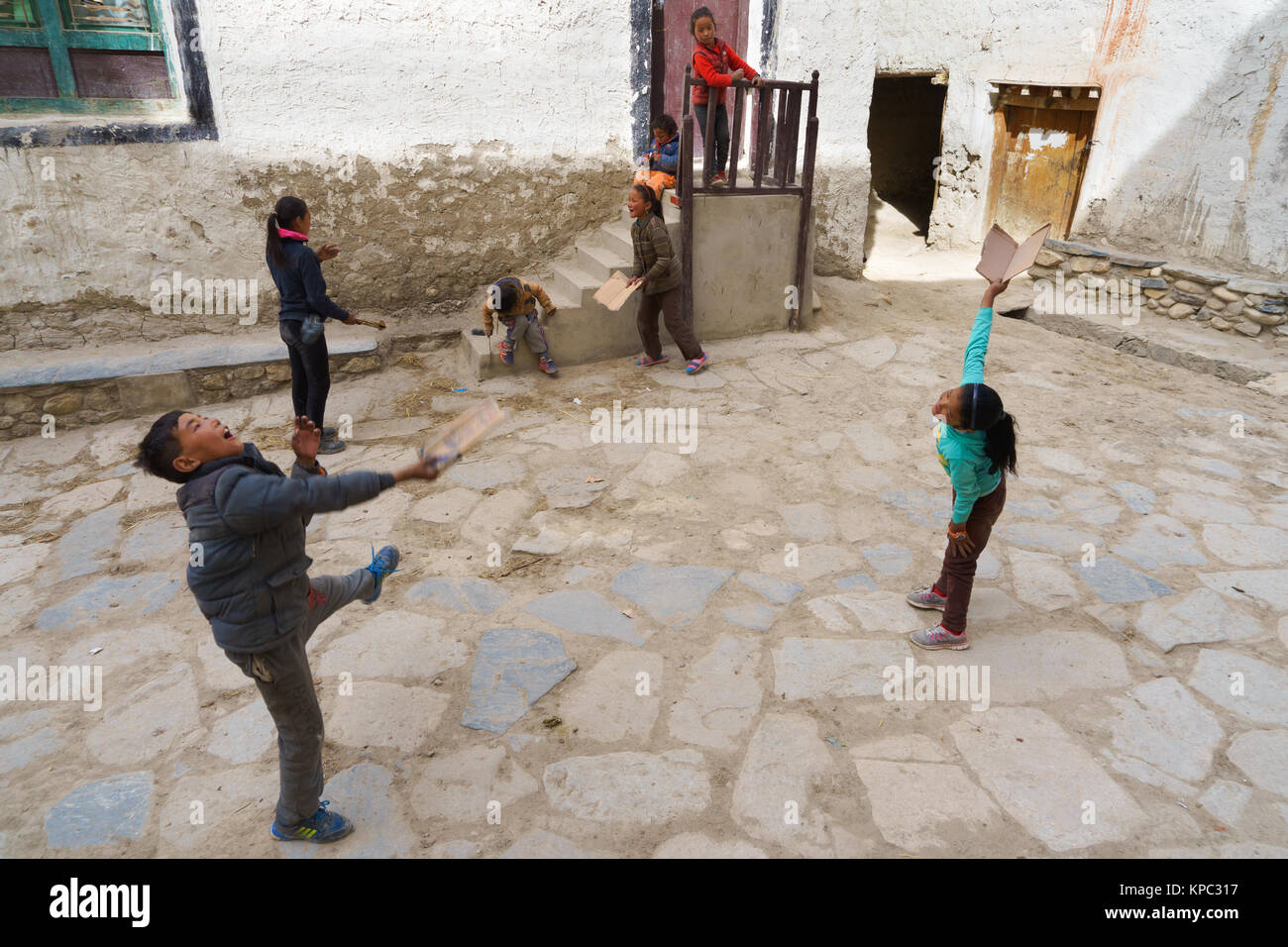 Tibetan children at play, Lo Manthang, Upper Mustang region, Nepal. - Stock Image