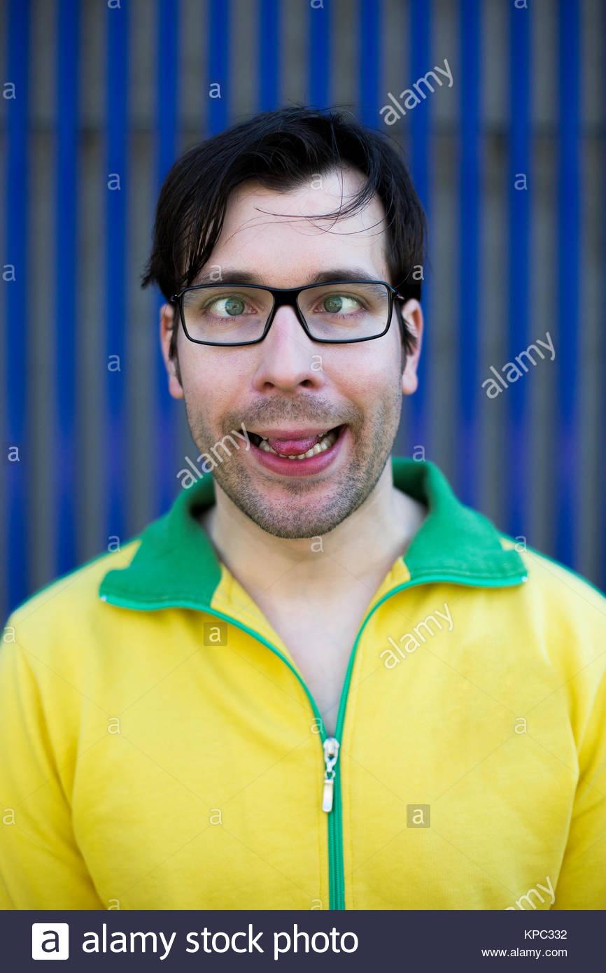 cross-eyed man making faces - Stock Image