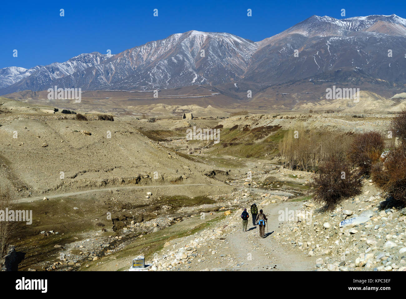 Trekkers exploring the Upper Mustang region near Lo Manthang, Nepal. - Stock Image