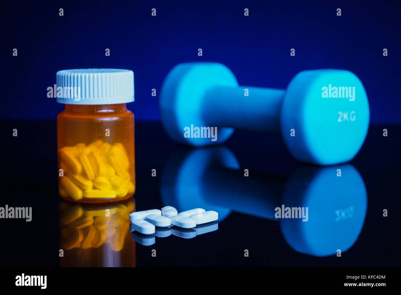 Dumbell and tablets - Stock Image