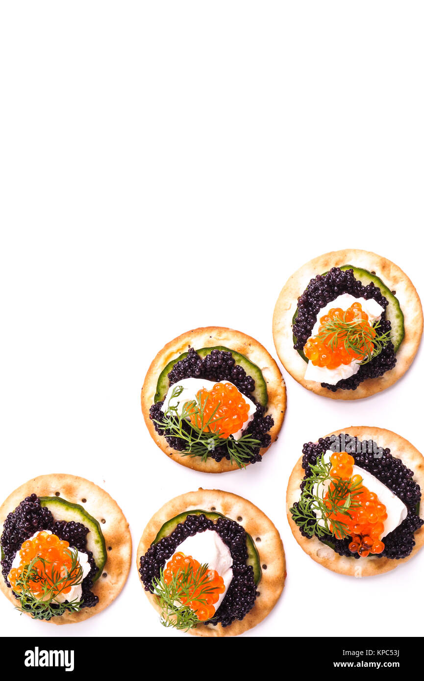 Caviar Appetizer served on crackers - Stock Image