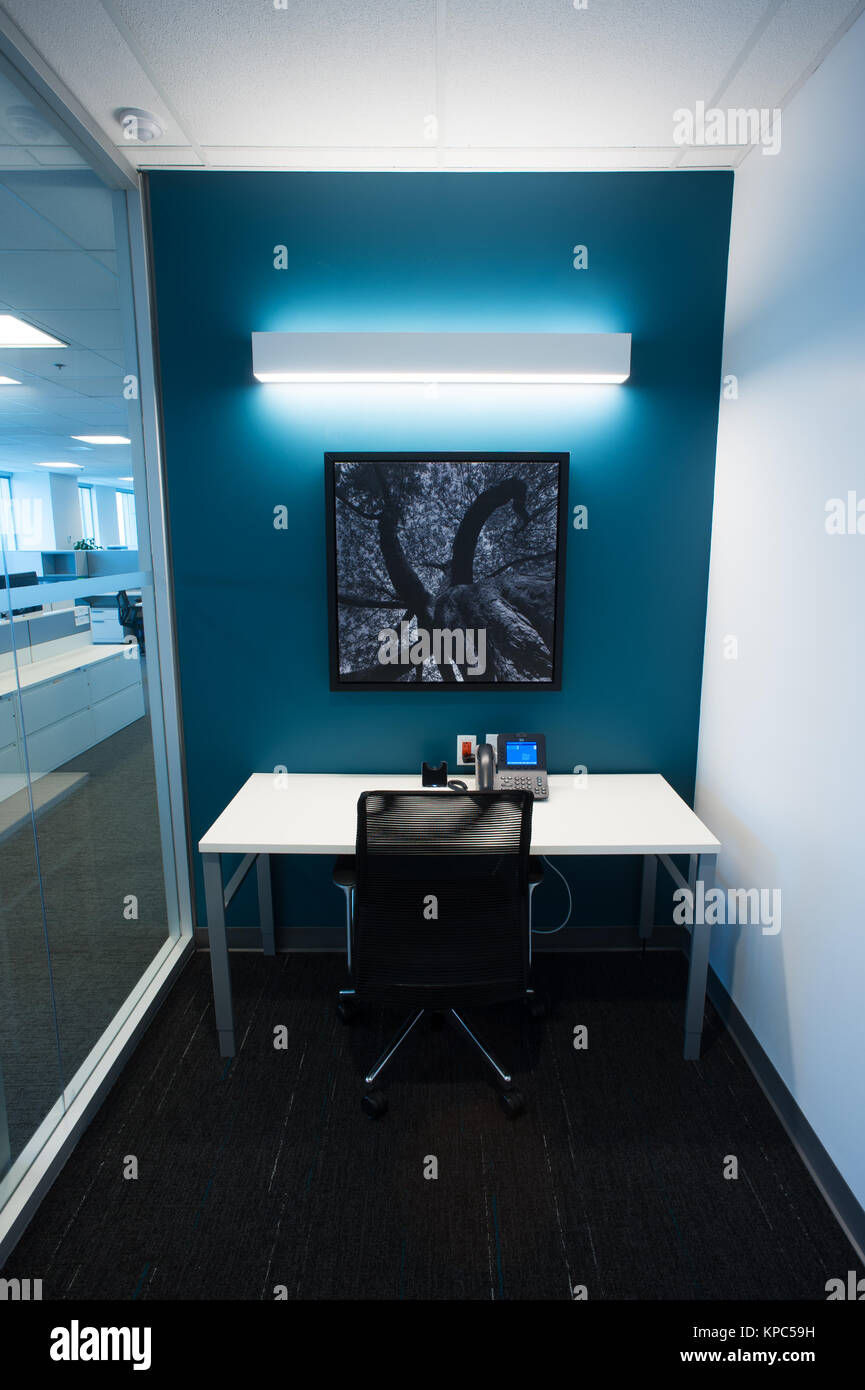 Small working space in a modern business office. - Stock Image