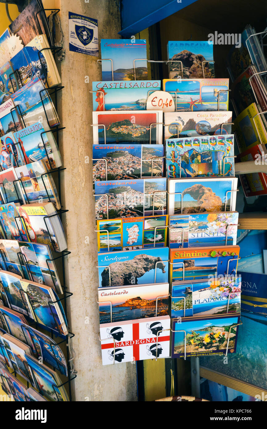 Picture postcards of Sardinia at a souvenir shop, Castelsardo, Sardinia, Italy, Mediterranean sea, Europe - Stock Image