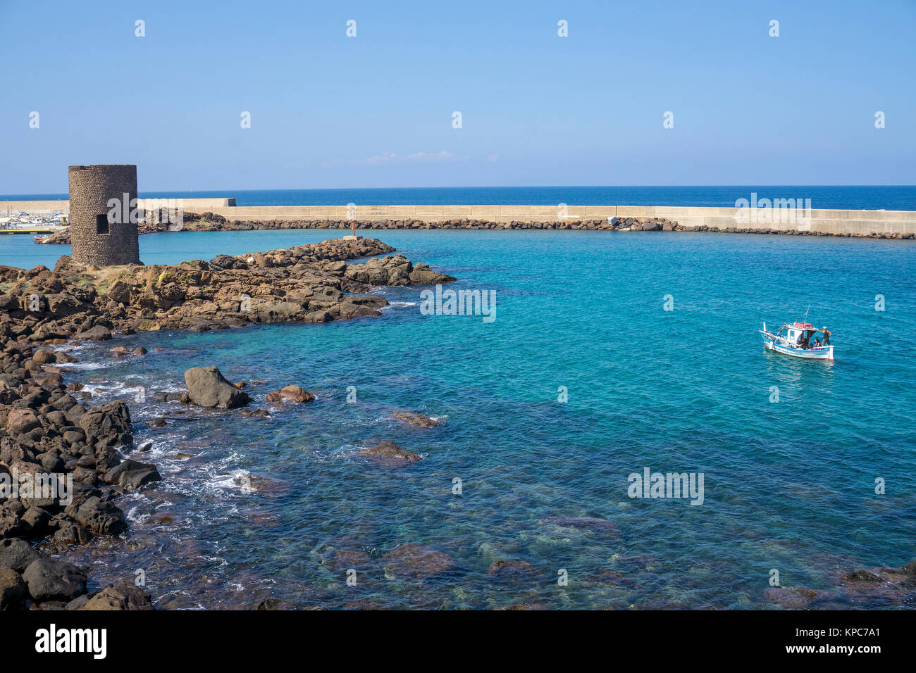 Fishing boat at the harbour entrance of Castelsardo, Sardinia, Italy, Mediterranean sea, Europe - Stock Image