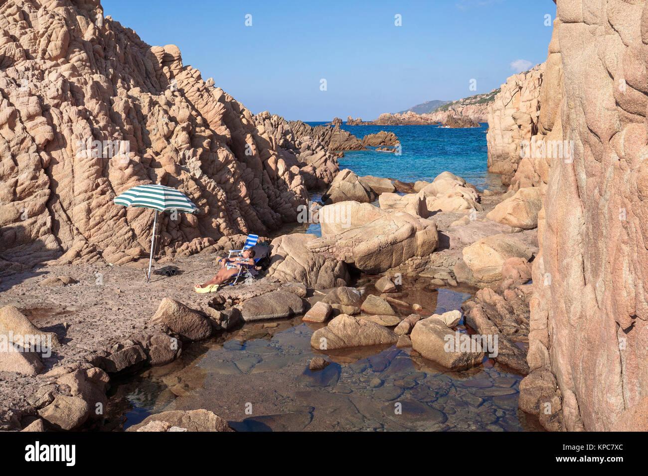 Idyllic bathing beach at rocky coast of Costa Paradiso, Porphyry rocks, Sardinia, Italy, Mediterranean  sea, Europe - Stock Image
