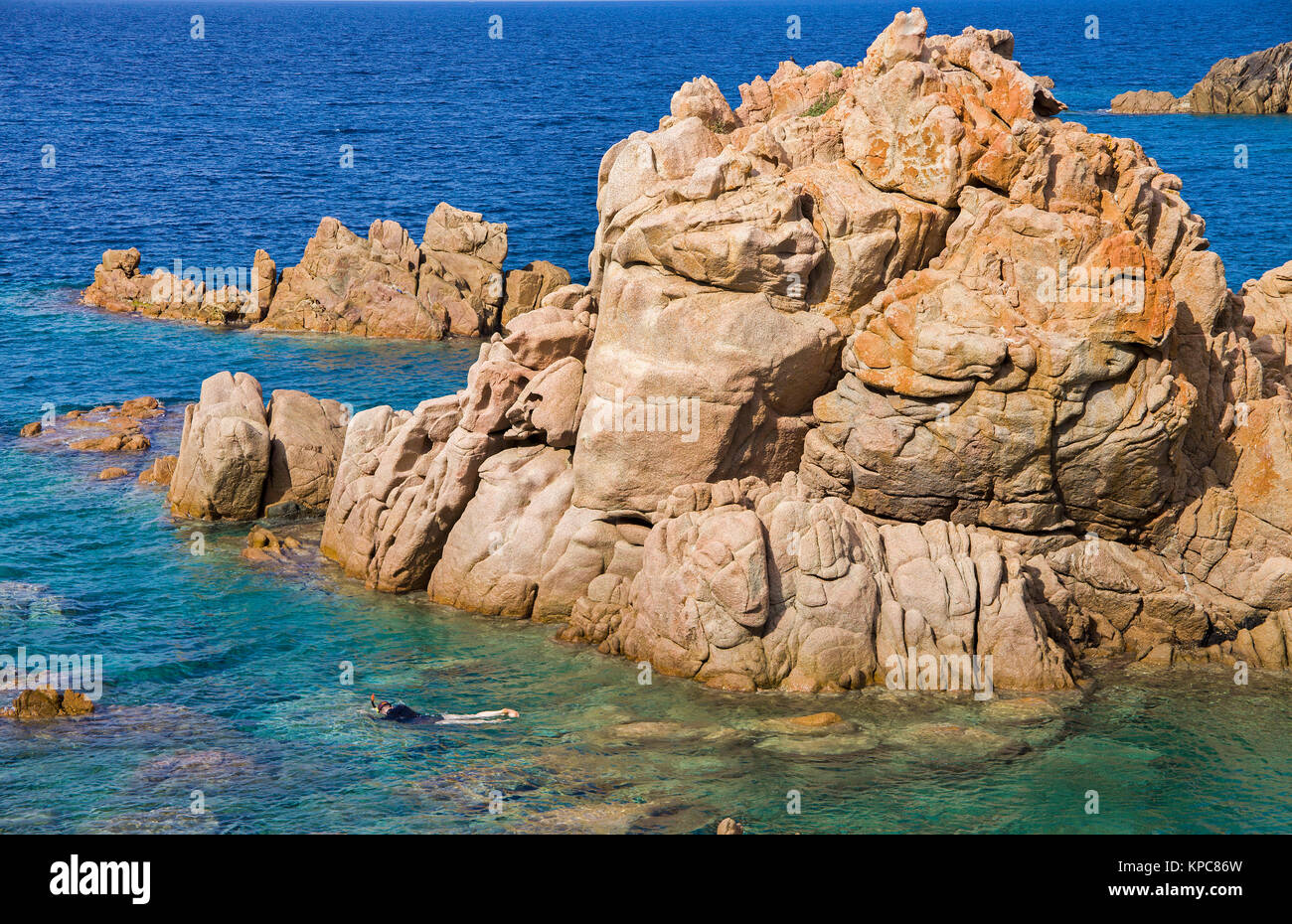 Snorkeler at porphyry rocks, Costa Paradiso, Sardinia, Italy, Mediterranean  sea, Europe - Stock Image