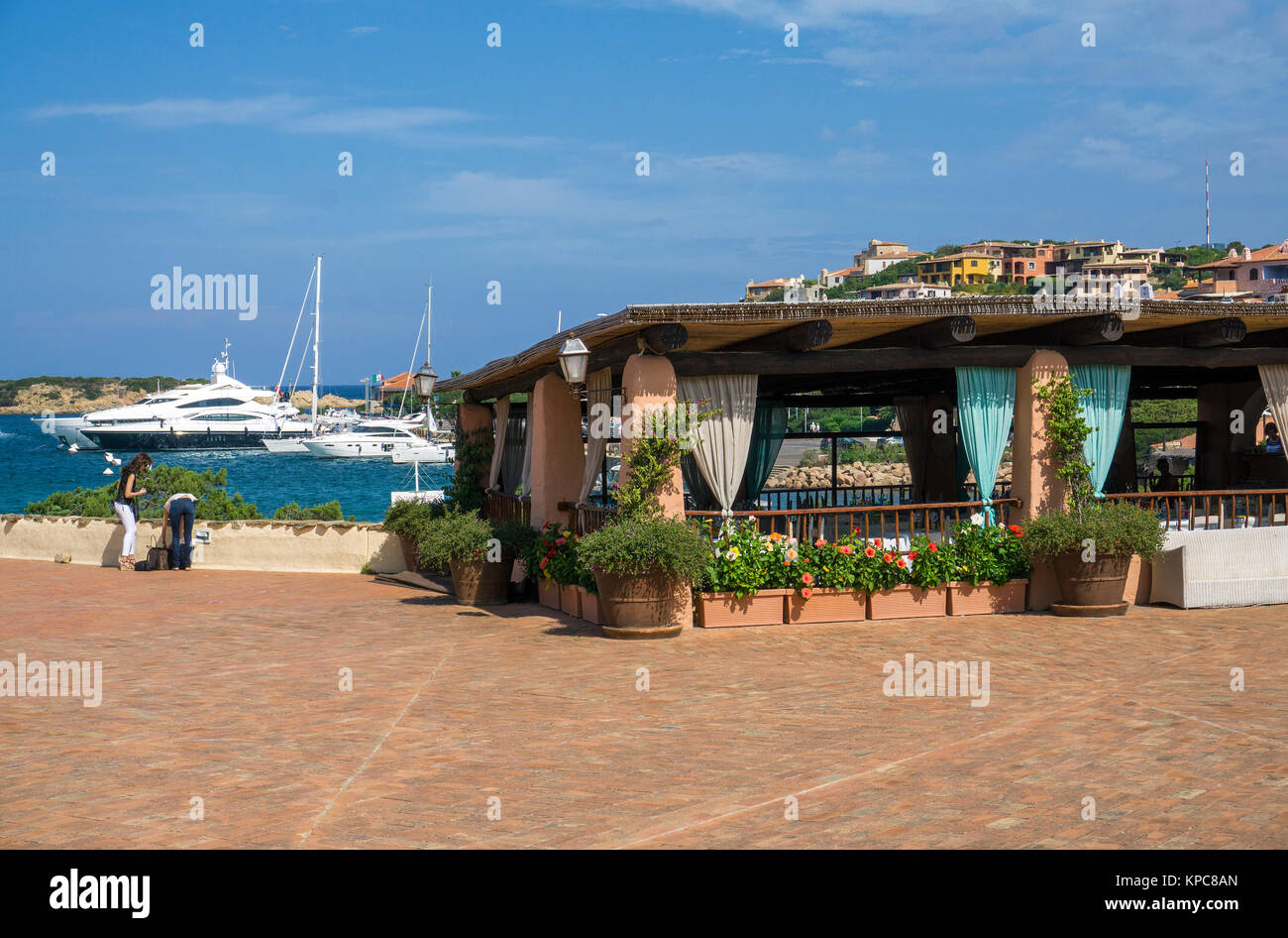 Restaurant with harbour view at Porto Cervo, luxury destination at Costa Smeralda, Sardinia, Italy, Mediterranean - Stock Image
