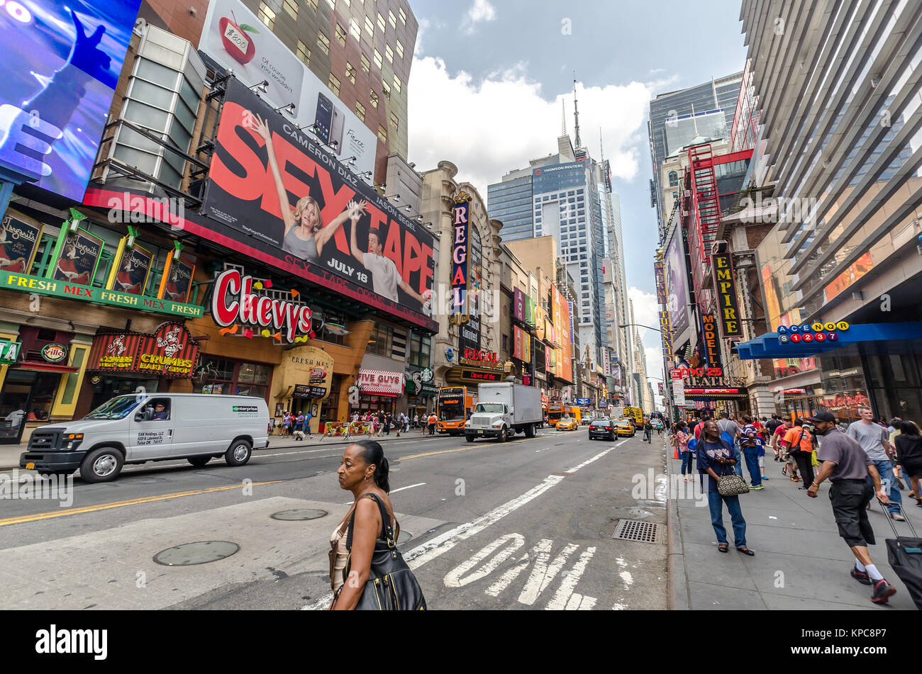 NEW YORK CITY - JUL 22: 42nd Street with traffic and commercials on July 22, 2014 in New York City. 42nd Street - Stock Image