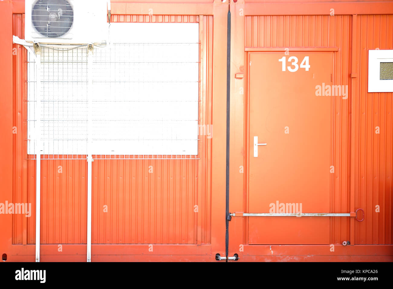 Building Container With Closed Door   Stock Image