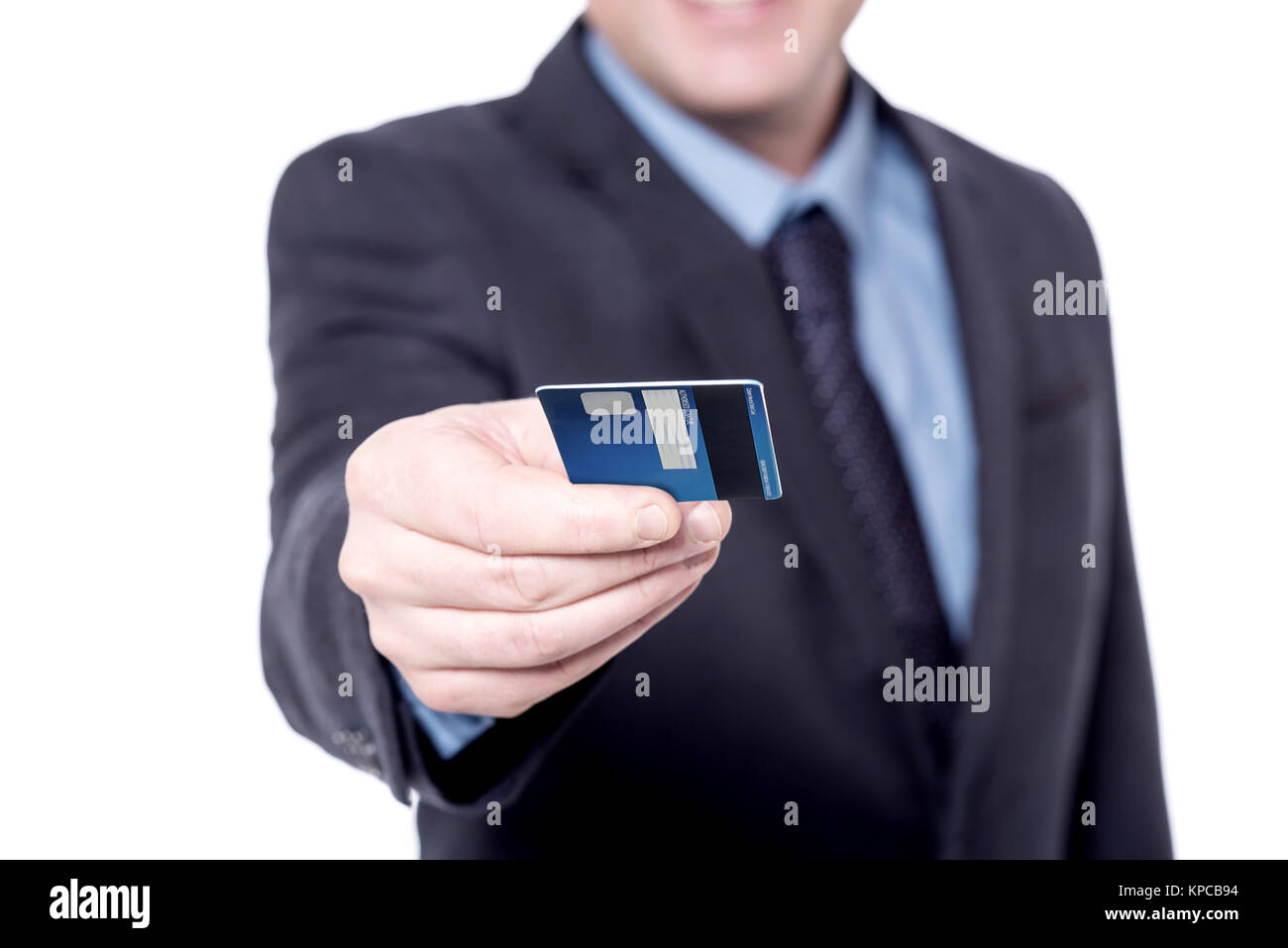 Focused image of businessman's hand with credit card - Stock Image