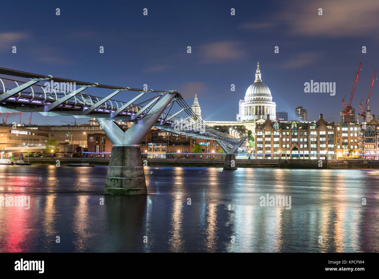 Millenium Bridge and St Paul's Cathedral by night, London, England, Great Britain - Stock Image