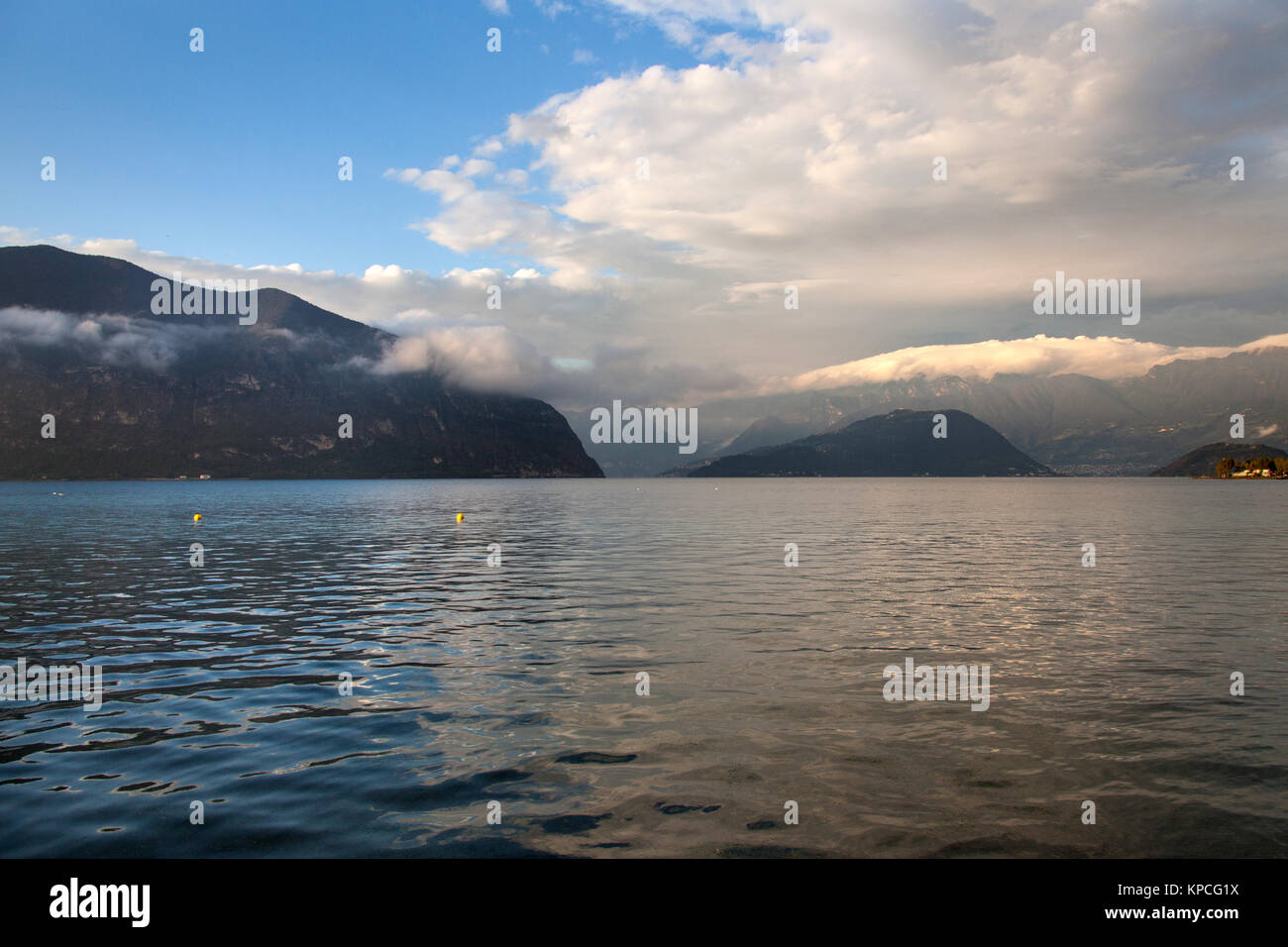 Lake Iseo, Italy. Picturesque dusk view of Lake Iseo, with the Predore peninsula on the left of the image and the Stock Photo