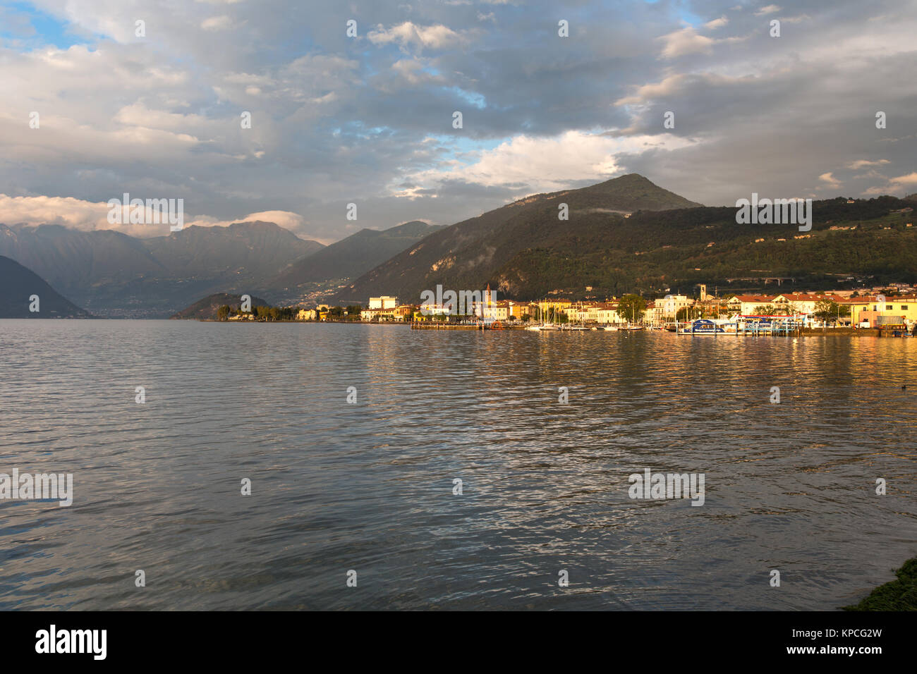 Lake Iseo, Italy. Picturesque dusk view of Lake Iseo, and the town of Iseo. The scene was captured looking eastwards - Stock Image