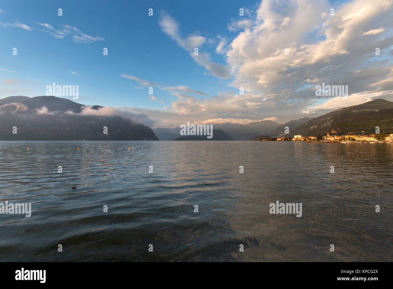 Lake Iseo, Italy. Picturesque dusk view of Lake Iseo, with the town of Iseo on the right of the image and the island - Stock Image
