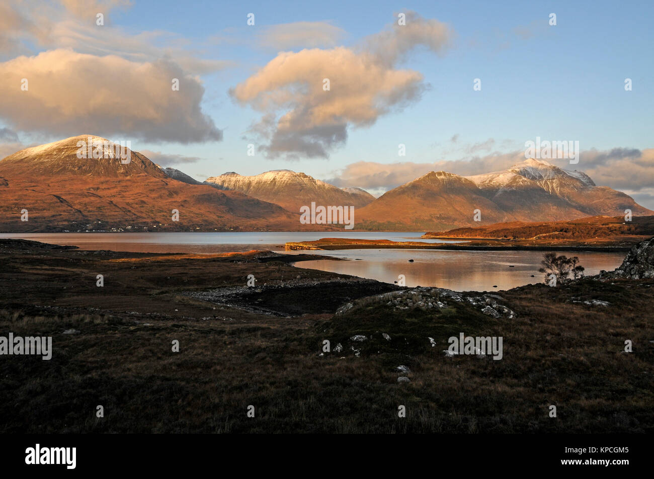 The snow-capped Torridon Mountains and Upper Loch Torridon  in Wester Ross, northwest Scotland, Britain - Stock Image