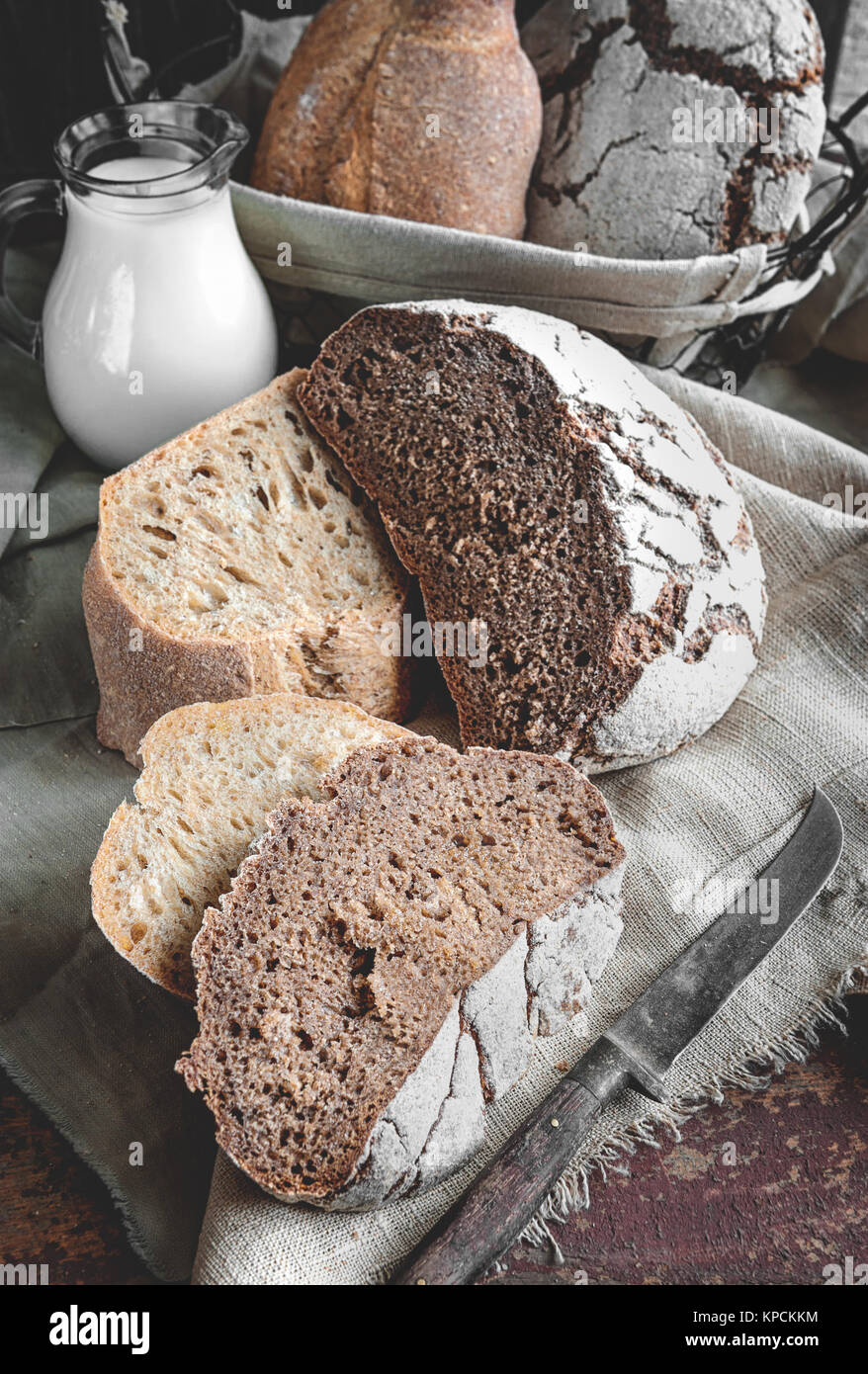 A beautiful loaf of rye farm sourdough bread is handmade. Close-up. - Stock Image