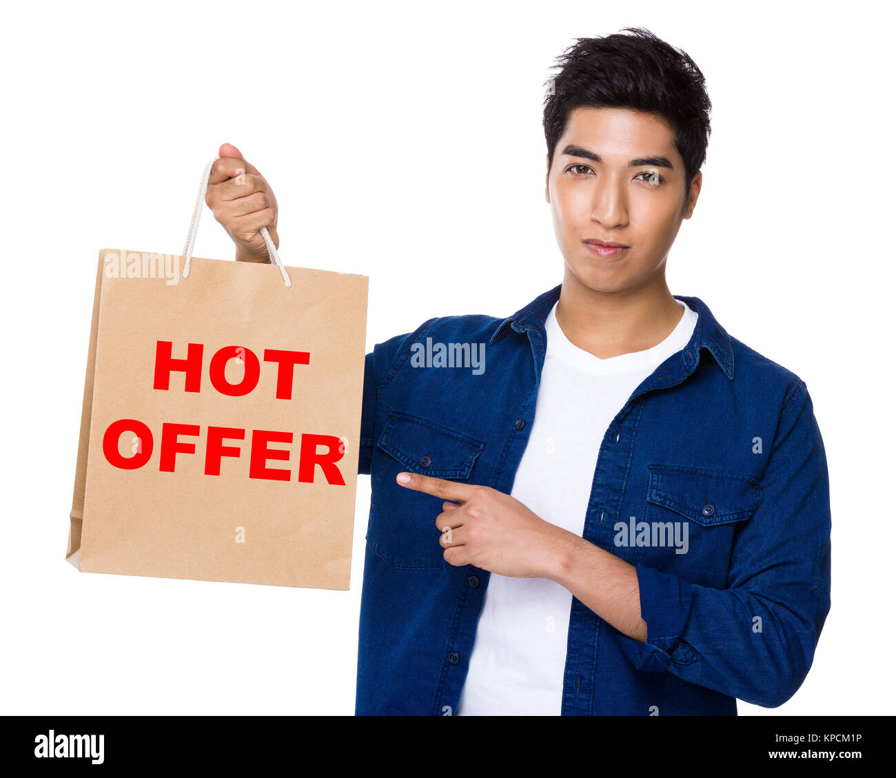 Asian mixed Indian man finger point to shopping bag for showing phrase of hot offer Stock Photo