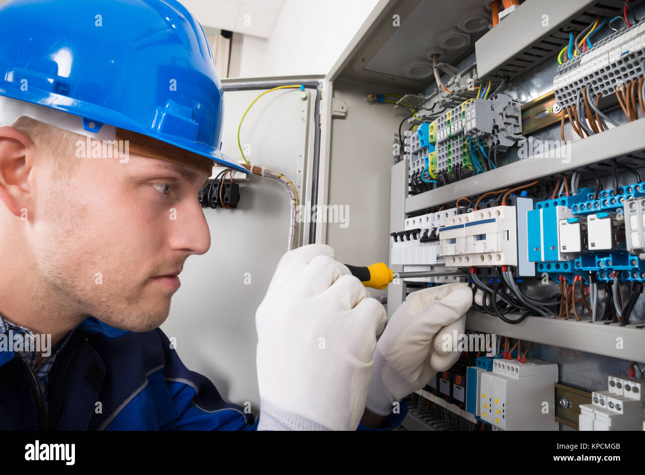Electrical Tester Stock Photos Images Alamy Mgb Fuse Box Male Electrician Examining Fusebox Image