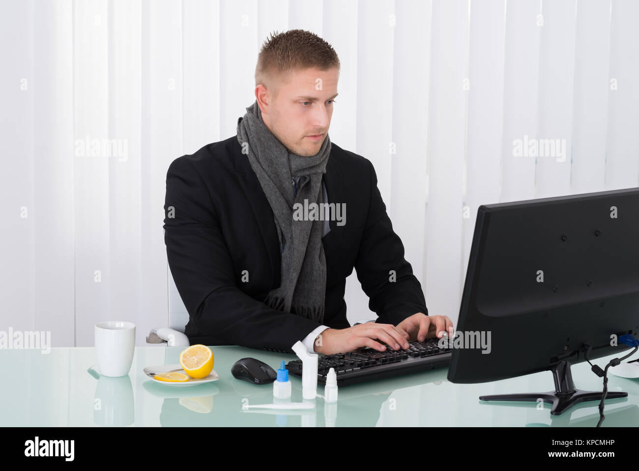 Sick Businessman Using Computer In Office - Stock Image