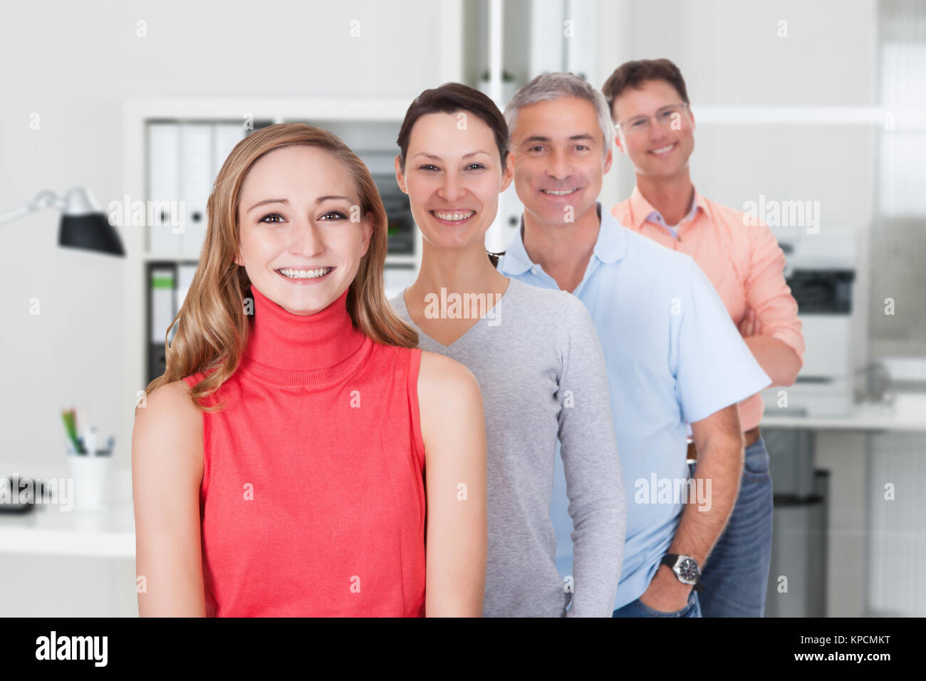 Four business associates in casual clothes Stock Photo