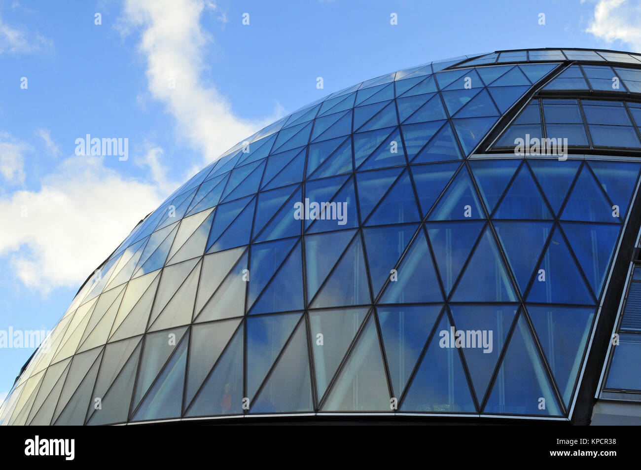 a close up or abstract angle or viewpoint of city hall on the south bank of the river thames near London bridge. - Stock Image