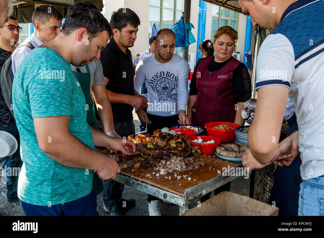 Cooks Carving Up Meat At The Central Asian Plov Centre, Tashkent, Uzbekistan - Stock Image