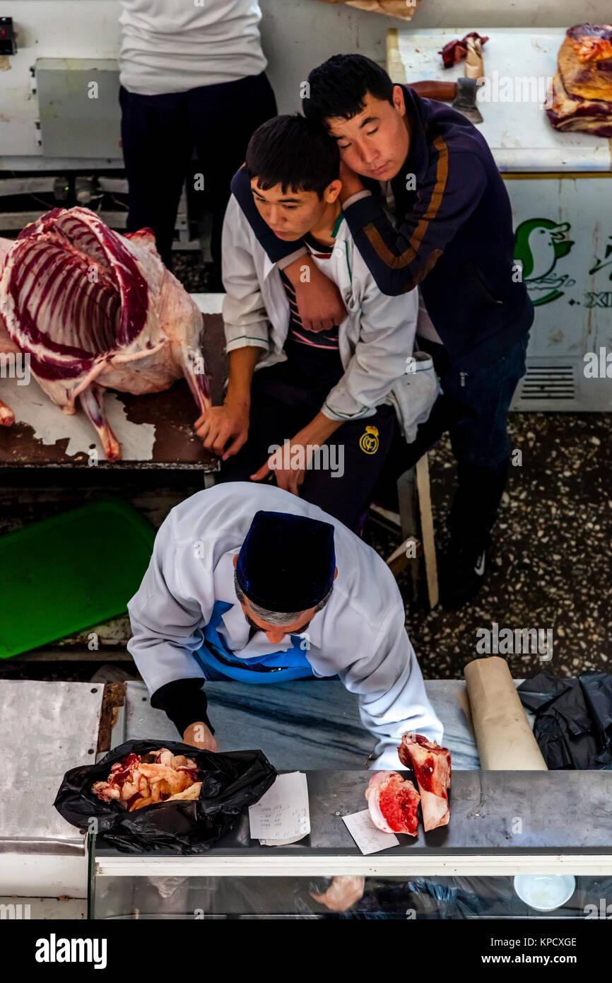 Meat Product Workers, Chorsu Bazaar, Tashkent, Uzbekistan - Stock Image
