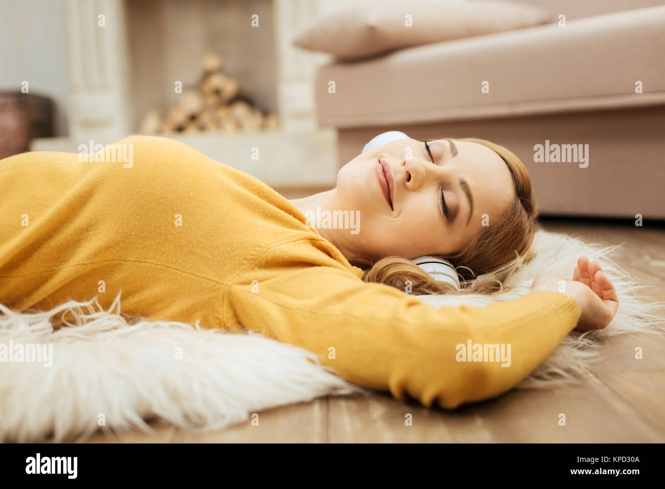 Glad woman listening to music with her eyes closed - Stock Image